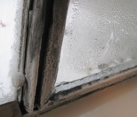 Ice buildup on the aluminum frame windows.