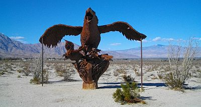 Huge metal birds appear about to take off from the desert floor.