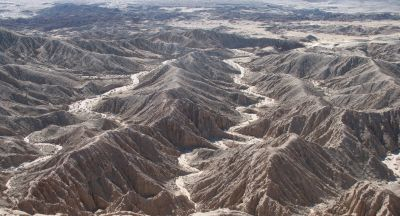 The result of the constant wind and intermittent water erosion flows down the washes from the heights.