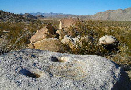 Morteros worn into the granite boulder!