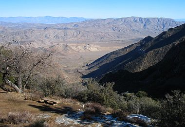 The Pacific Crest Trail crosses right in front of us, with a convenient bench for weary hikers!